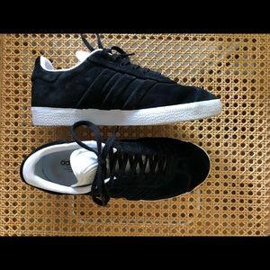 Black suede Adidas Gazelle sneakers